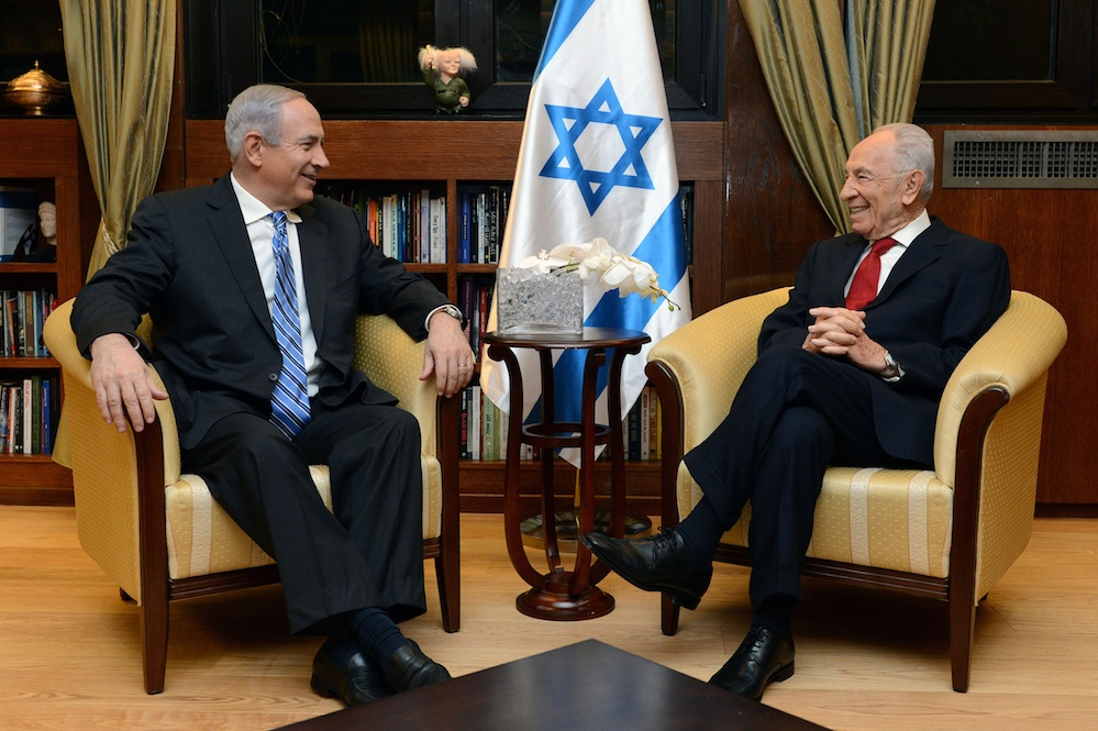 Click photo to download. Caption: Israeli Prime minister Benjamin Netanyahu meets Israeli President Simon Peres on March 16 in Jerusalem to inform Peres that he has formed an Israeli government coalition with the Yesh Atid, Jewish Home and Movement parties. Credit: Kobi Gideon/GPO/FLASH90.