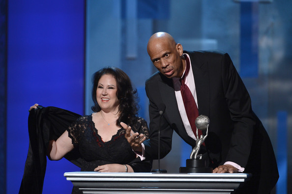 Click photo to download. Caption: Kareem Abdul-Jabbar and his manager Deborah Morales at the podium during the 2013 NAACP Image Awards. Credit:  Raymond Obstfeld.