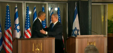 Prime Minister Benjamin Netanyahu shakes hands with President Barack Obama in Israel Wednesday during their joint press conference. Credit: Israel Hayom video screenshot.