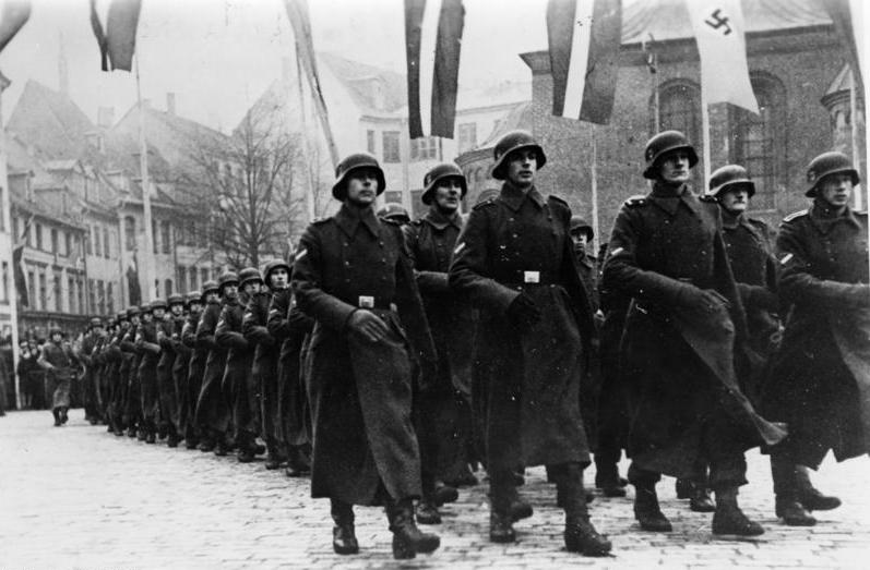 Click photo to download. Caption: The Latvian Waffen-SS Legion marching on Latvian Independence Day, 1943. Credit: German Federal Archives.