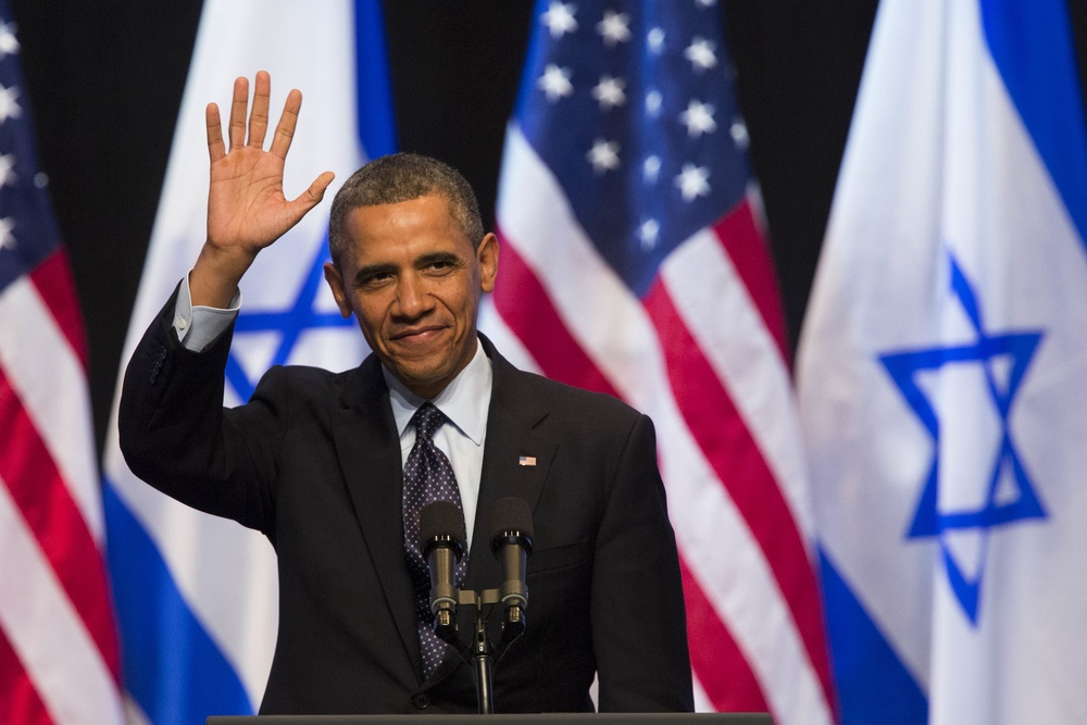 Click photo to download. Caption: U.S. President Barack Obama waves before addressing Israeli students at the International Convention Center in Jerusalem on March 21, 2013. Credit: Yonatan Sindel/Flash90.