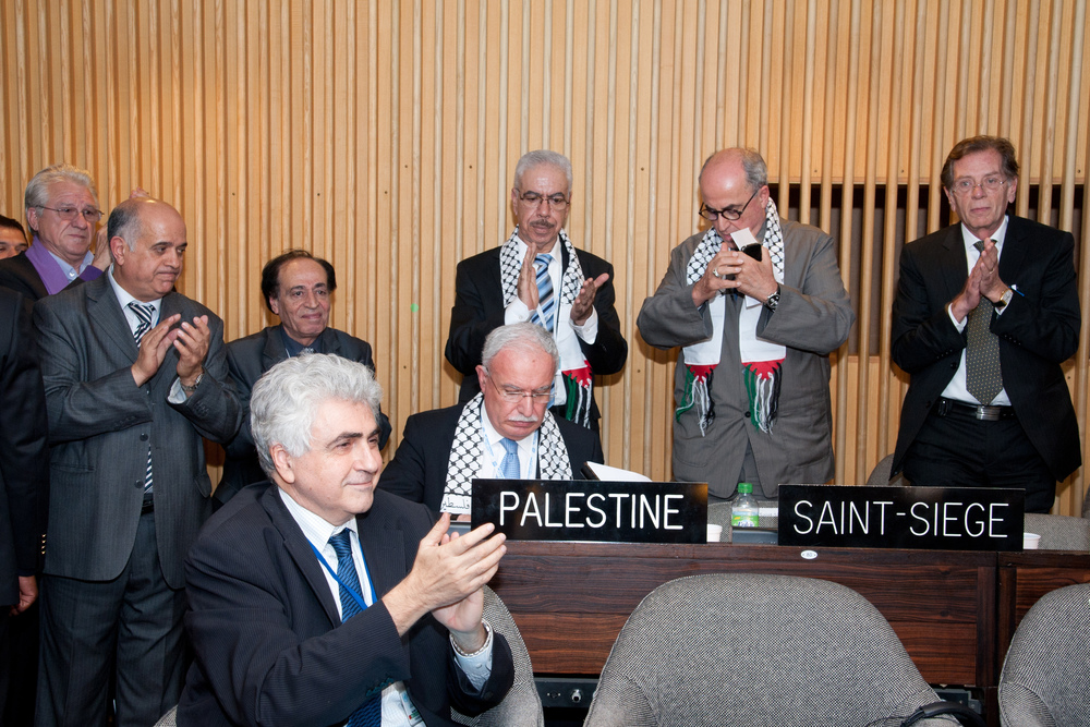 "Palestinian Authority and other delegates applauding aftet the General Conference admits ""Palestine"" as a UNESCO member state in Paris on Oct. 31, 2011. Credit: EPA/DOU MATAR/UNESCO/HANDOUT"