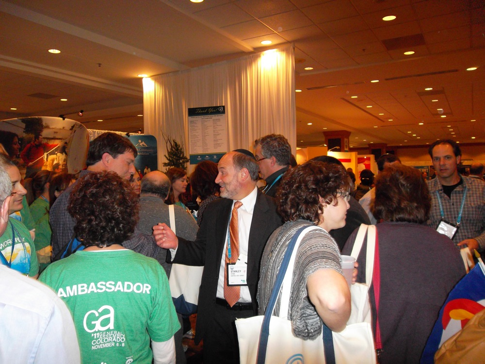Frantic networking in the GA exhibit hall following the 2011 program's opening plenary in Denver. Credit: Jacob Kamaras.