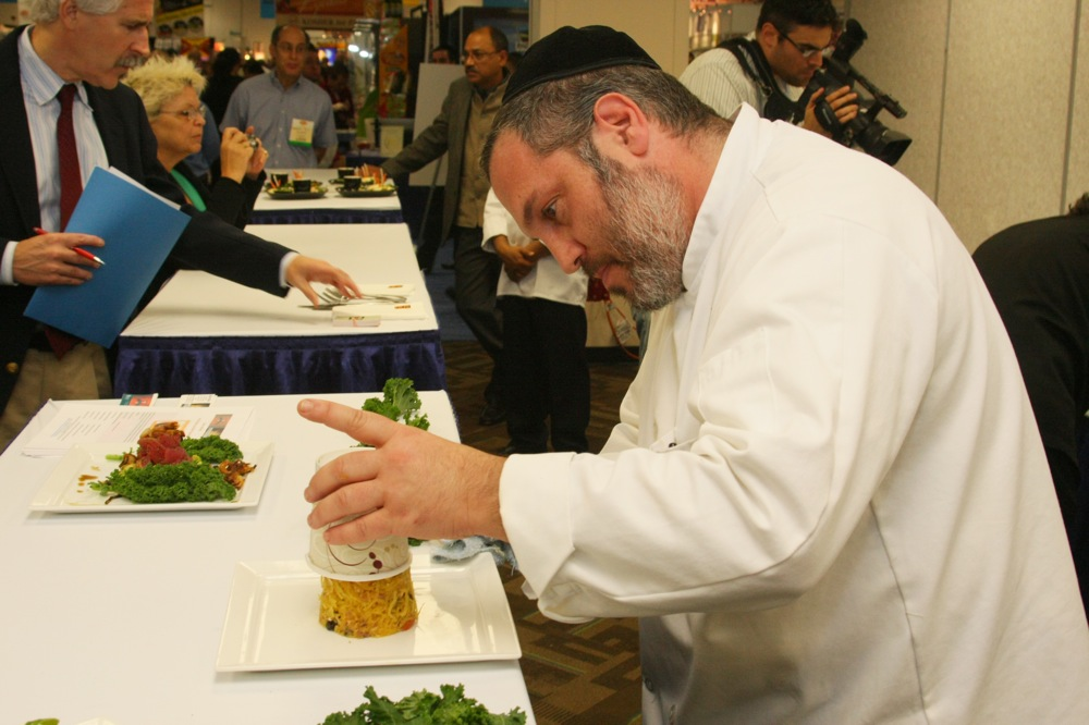 Click photo to download. Caption: An exhibitor at Kosherfest in Secaucus, NJ. Credit: Kosherfest.