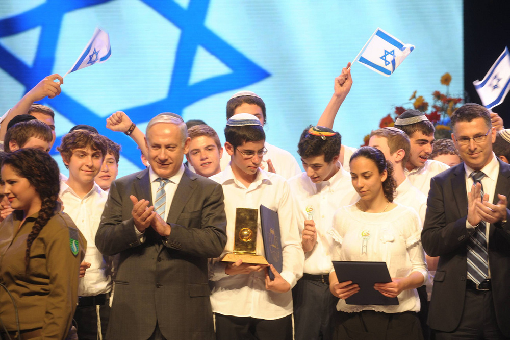 Click photo to download. Caption: Prime Minister Benjamin Netanyahu at the international bible competition for youth on Israel Independence Day (Yom Ha'atzmaut) in 2011. Credit: Amos Ben Gershom/GPO.