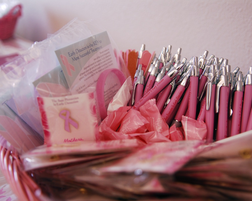 Click photo to download. Caption: Breast cancer awareness ribbons and pens. Credit: Wikimedia Commons.