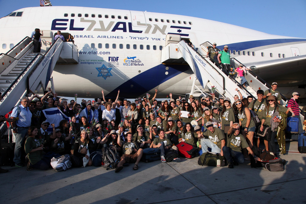 Click photo to download. Caption: The Aug. 15 Nefesh B'Nefesh flight brought 360 new olim to Israel. Credit: Sasson Tiram, courtesy of Nefesh B'Nefesh.