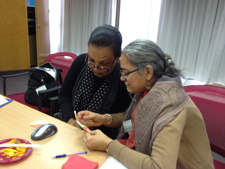 Click photo to download. Caption: Maryse Penette Kedar (Haiti) and Mirai Chatterjee (India) meet during JDC's first-ever women's leadership workshop in Jerusalem. Credit: Danielle Butin.