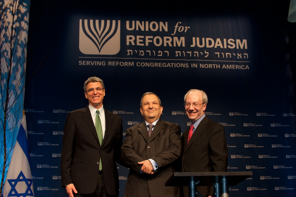 Click photo to download. Caption: New Union for Reform Judaism President Rabbi Rick Jacobs (far left) and outgoing URJ President Rabbi Eric Yoffie flank Ehud Barak at the URJ biennial convention in Washington, DC. Credit: Courtesy Union for Reform Judaism.