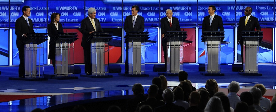 Click photo to download. Caption: (L-R) Former Pennsylvania senator Rick Santorum, Representative Michele Bachmann of Minnesota, former Speaker of the House Newt Gingrich, former Massachusetts Governor Mitt Romney, Representative Ron Paul of Texas, former Minnesota Governor Tim Pawlenty and businessman Herman Cain of Georgia watch a video monitor during the CNN Republican presidential candidate debate held at St. Anselm College in Manchester, New Hampshire, on June 13, 2011. Credit: EPA/CJ GUNTHER.