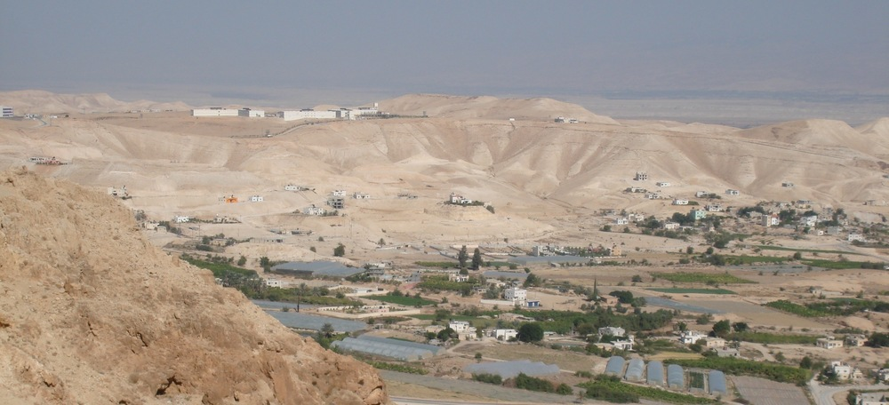 Click photo to download. Caption: A view of Jericho with the PA police training facility visible on the back hill. Credit: Benjamin Balint.