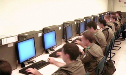 Israeli Soldiers manning stations in the National Cyber Bureau. Credit: IDF Spokesperson's Unit.