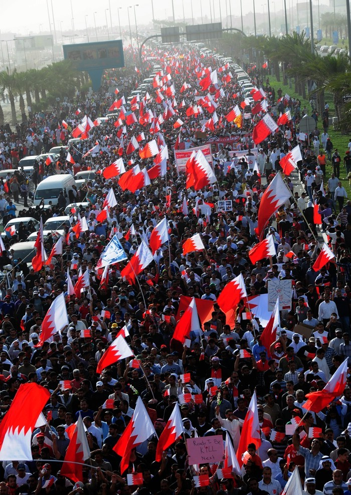 "Click photo to download. Caption: A pro-democracy march in Bahrain, inspired by the Arab Spring, in February 2011. Houda Ezra Ebrahim Nonoo, Bahrain's ambassador to the U.S., says the Arab Spring ""has certainly changed my job in Washington."" Credit: Lewa'a Alnasr/Wikimedia Commons."