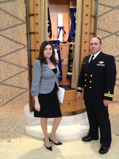 Click photo to download. Caption: Houda Ezra Ebrahim Nonoo, Bahrain's ambassador to the U.S., with Lt. Josh Sherwin, USN, the Jewish chaplain at the U.S. Naval Academy, in front of the Ark at the Miller Chapel, Uriah Levy Center. Credit: U.S. Naval Academy.