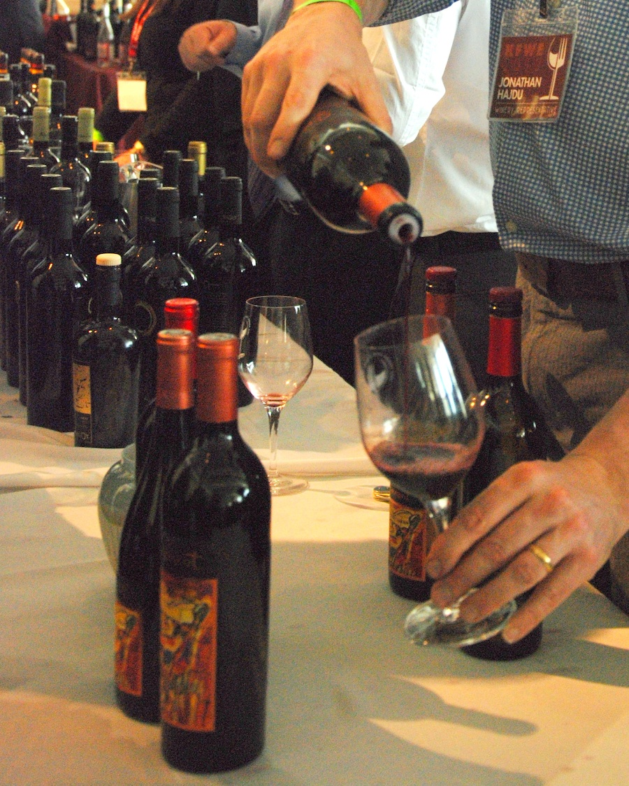 Click photo to download. Caption: A fine wine—one of several hundred—sampled at the 2012 Kosher Food and Wine Experience. Vintners from around the globe introduced a wide range of kosher wines to discerning palates at the one day extravaganza. Here, Covenant associate winemaker Jonathon Hajdu pours an extraordinary red produced by the Northern California kosher winery. Credit: Maxine Dovere.