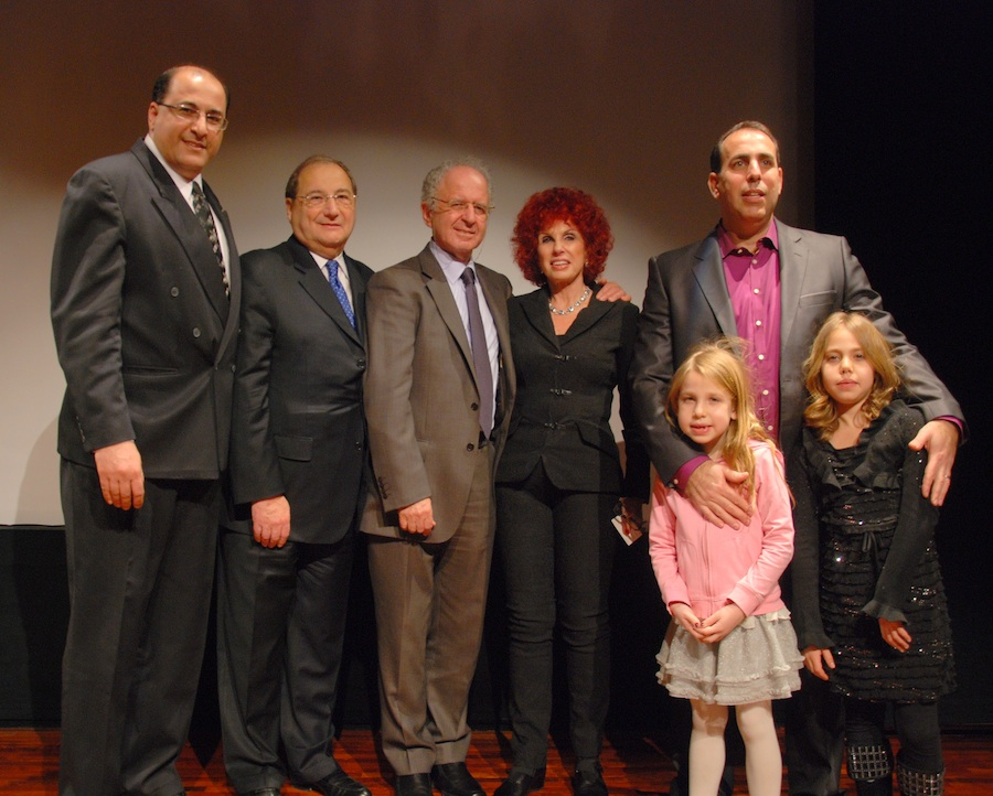Click photo to download. Caption: At the 50th Anniversary Commemoration of the Eichmann Trial, (from left) H.E. Ido Aharoni, Consul General of Israel in New York, Abraham H. Foxman, National Director of the Anti-Defamation League, a child survivor, Yehudah Raveh, Mrs. Tamar Hausner Raveh, daughter of Gideon Hausner, the Chief Prosecutor during the trial, Itai Arad, grandson of Isser Harel, leader of the team that captured the Eichmann in Argentina. Pictured with Arad are Zoe and Emma, his daughters. Credit: Maxine Dovere.