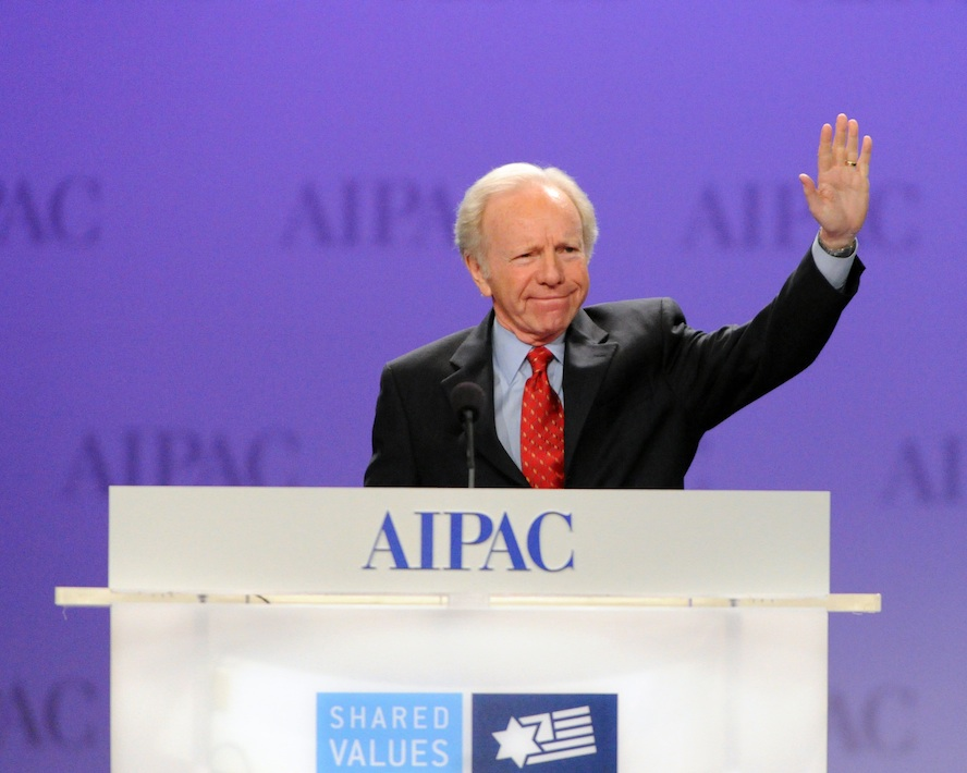 Click photo to download. Caption: U.S. Sen. Joe Lieberman waves to AIPAC delegates March 5 in Washington, DC. He spoke at the AIPAC convention for the last time as a senator, with his talk covering Purim and the Jewish biblical right to Israel, among other topics. Credit: AIPAC.