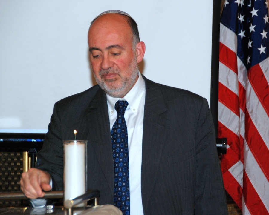 Click photo to download. Caption: On Monday night in New York, Ron Prosor, Israel's Permanent Representative to the United Nations, lights a candle at a memorial for the 20th anniversary of the Israeli embassy bombing in Buenos Aires, Argentina. Credit: Maxine Dovere.