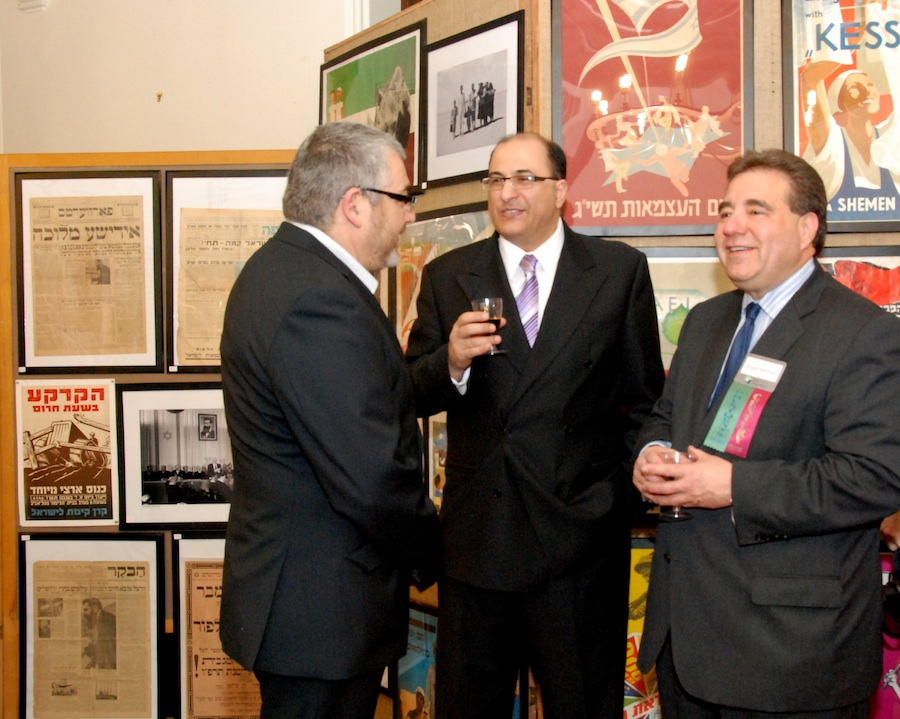 "Click photo to download. Caption: Aharon Farkash (left), director of the Farkash Gallery in Israel, joins Israel's Consul General in New York Ido Aharoni and Jewish National Fund CEO Russel F. Robinson March 28 at the opening of the ""Made in Israel 2012"" exhibit (which can be seen in the background). Credit: Maxine Dovere."