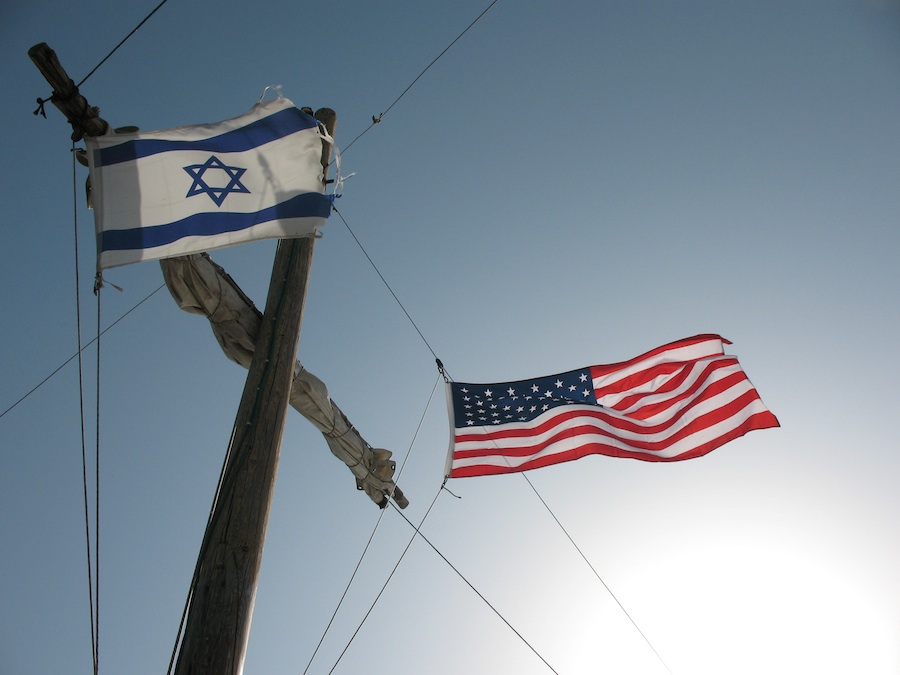 Click photo to download. Caption: Israeli and American flags. Credit: James Emery.