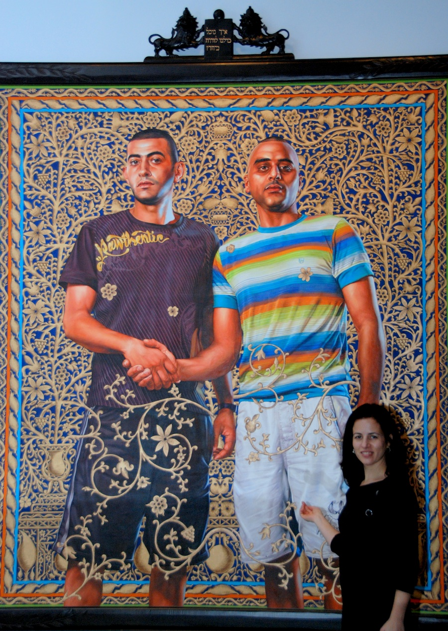"Click photo to download. Caption: Associate Curator of the Jewish Museum Karen Levitov is dwarfed by the monumental work of Kehinde Wiley. Titled ""Abed Al Ahse and Chalked El Aweari,"" this painting shows two young men in Israel. Credit: Maxine Dovere."