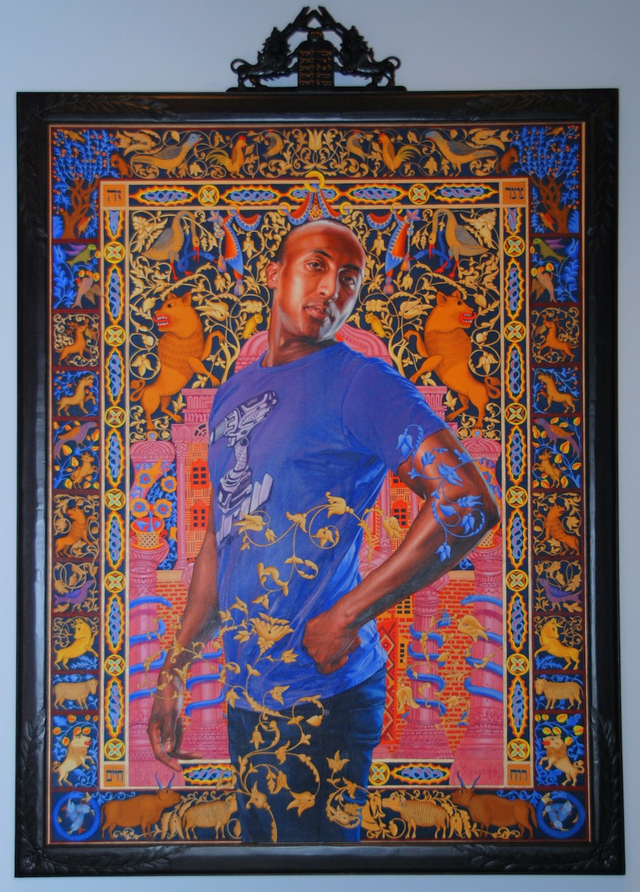 "Click photo to download. Caption: At the Jewish Museum in New York, Kehinde Wiley's painting ""Alios Itzhak"" shows an Israeli of Ethiopian heritage against a background image of an ancient European Torah cover. Credit: Maxine Dovere."
