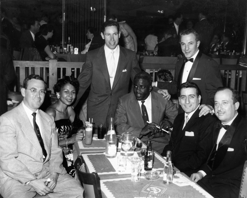 "Click photo to download. Caption: In center, baseball legend Jackie Robinson at the Grossinger's hotel during the heyday of the ""Borscht Belt."" Credit: Jackie Horner."