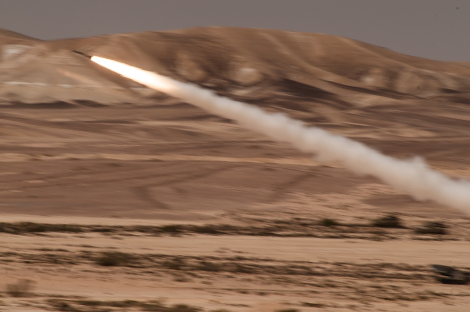Click photo to download. Caption: An Israeli Army MLRS rocket streaks across an open desert plain, as it homes in on an enemy stronghold in a mock assault display held at the Shivta Field Artillery Base, in southern Israel, Thursday, May 24, 2012. Credit: B. Davidson.