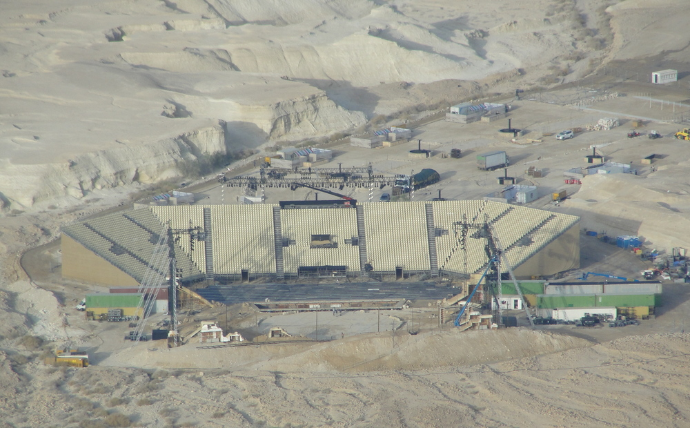 Click photo. Caption: The massive stage and seating area for 7,500 is built for performances of the opera Carmen at Masada. Credit: Judy Lash Balint.