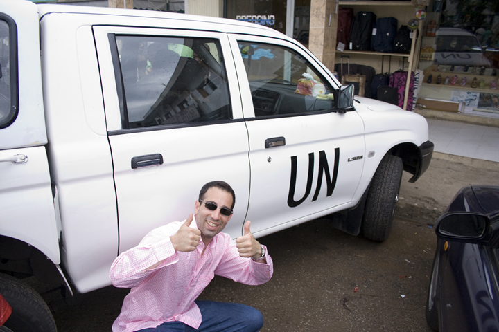 Click photo to download. Caption: Following his satirical film style, director Ami Horowitz poses with a UN vehicle in Cote d'Ivoire. Credit: Courtesy U.N. Me