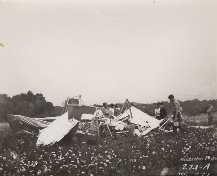 Click photo to download. Caption: Men surveying the wreckage of the crash that killed Arthur Welsh on June 11, 1912. In center with his head turned is Lt. (later 5-Star General) Henry Arnold. Credit: Courtesy of the College Park Aviation Museum.