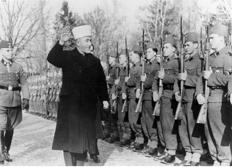 Click photo to download. Caption: Haj Amin el-Husseini, better known as the Grand Mufti of Jerusalem, with Nazi SS officers in November 1943. Credit: German Federal Archives.