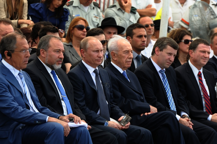Click photo to download. Caption: In center, Russian President Vladimir Putin sits between Foreign Minister Avigdor Lieberman and President Shimon Peres at a dedication ceremony for a monument in Netanya commemorating the Red Army's victory over the Nazis. Credit: GPO.