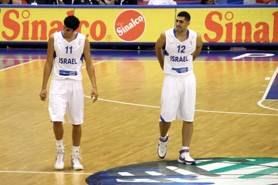 Click photo to download. Caption: Israeli basketball players Lior Eliyahu (left) and Moshe Mizrahi at a November 2011 game. Eliyahu, whose NBA rights were traded June 26 from Houston to Minnesota, still hopes to make the American league. Credit: Klearchos Kapoutsis.