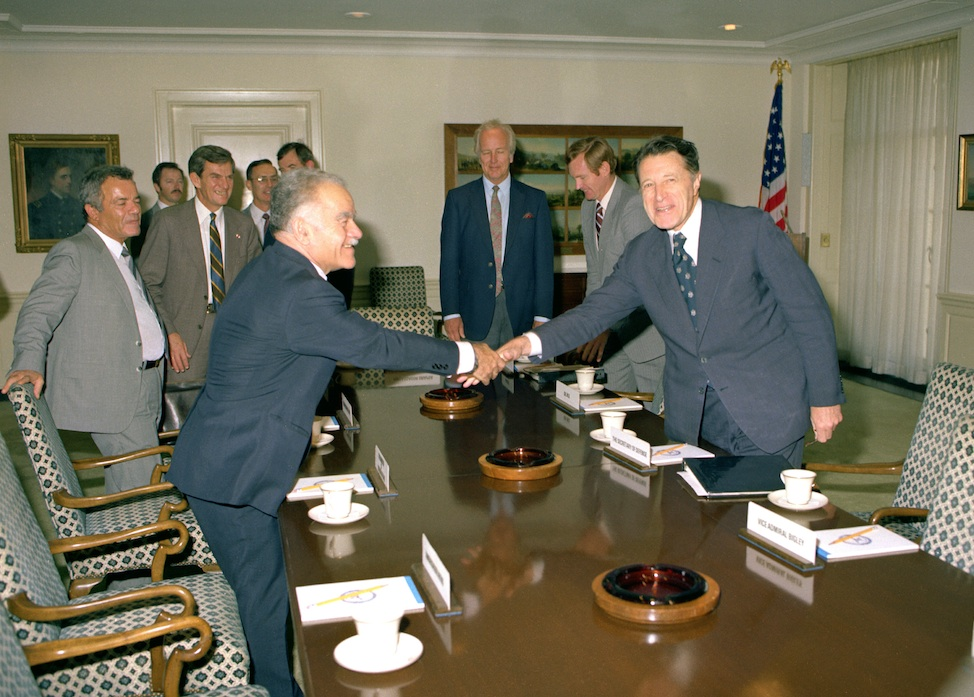 Click photo to download. Caption: U.S. Secretary of Defense Caspar Weinberger (right) greets Israeli Minister of Foreign Affairs Yitzhak Shamir in a Pentagon Conference Room in 1982. In 1983, Shamir rose to prime minister. Credit: Frank Hall.