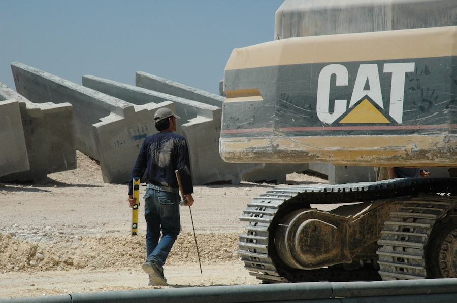 Click photo to download. Caption: A Caterpillar bulldozer amid construction of the Israeli West Bank security fence. Credit: Justin McIntosh.