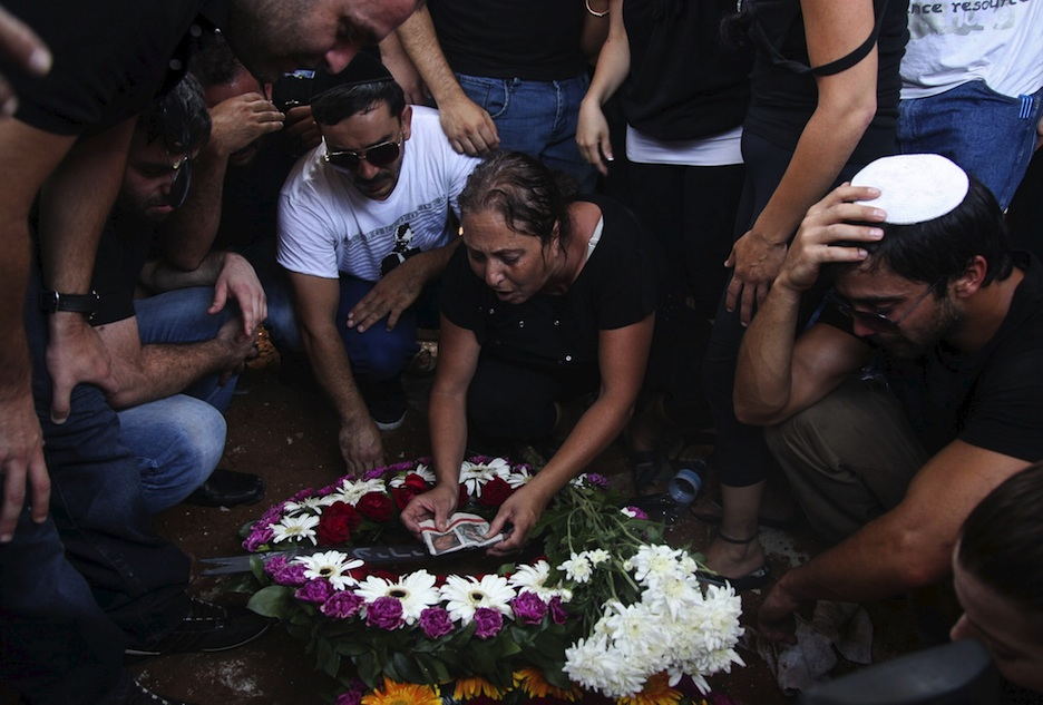 Click photo to download. Caption: Friends and family mourn at the funeral of Maor Harosh, 25, in Acre on July 20, 2012. Harosh was killed together with four other Israelis in a suicide bombing attack in Bulgaria. Credit: Avishag Shaar-Yashuv/FLASH90.