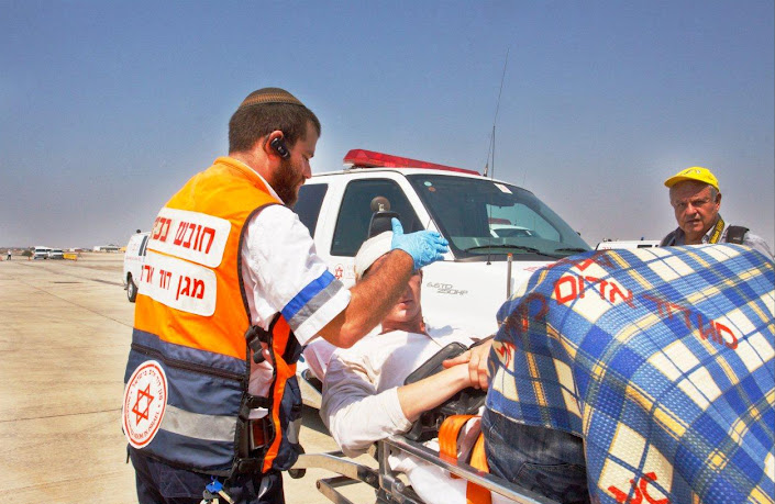 Click photo to download. Caption: Magen David Adom (personnel) tend to an injured man in Bulgaria following the terrorist attack on a bus carrying Israelis. Credit: MDA Israel.