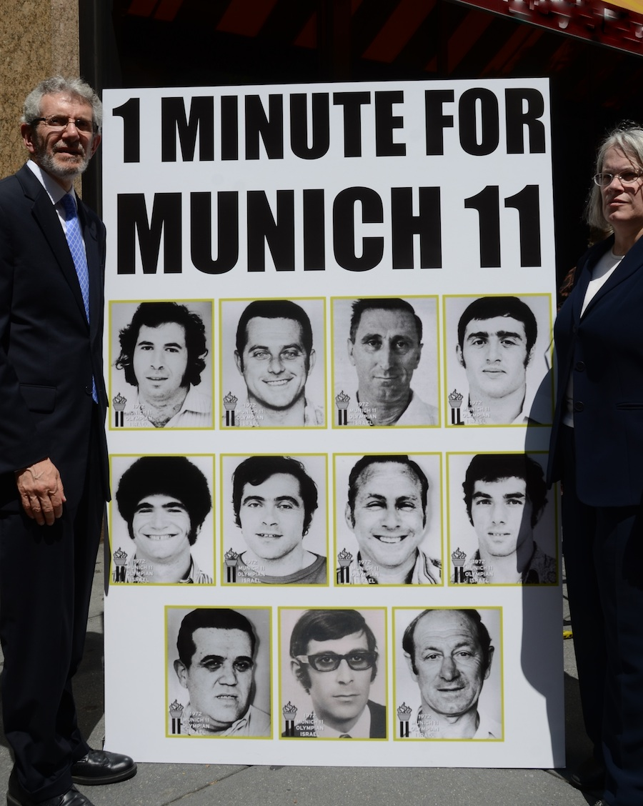 Click photo to download. Caption: In New York City on July 27, Jewish Community Relations Council (JCRC) Director Rabbi Michael Miller (left) and New York Assemblywoman Helene Weinstein stand by photos of the Israeli team members killed at the 1972 Munich Olympics. Credit: Maxine Dovere.