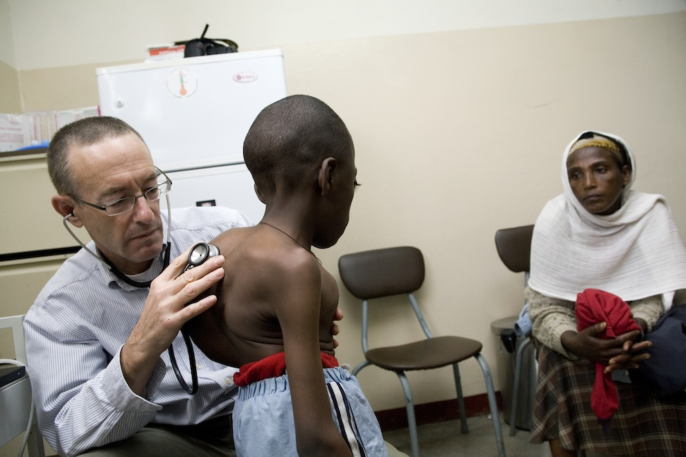 Click photo to download. Caption: JDC's Dr. Rick Hodes treats a child in Ethiopia. Credit: Richard Lord/JDC.