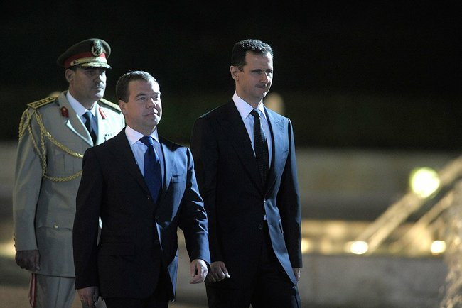 Click photo to download. Caption: Syrian President Bashar al-Assad (right) with Russian Prime Minister Dmitriy Medvedev. Another Russian official, Deputy Foreign Minister Mikhail Bogdanov, reportedly told the Saudi newspaper Al-Watan Tuesday that Assad is ready to step down. Credit: Presidential Press and Information Office.