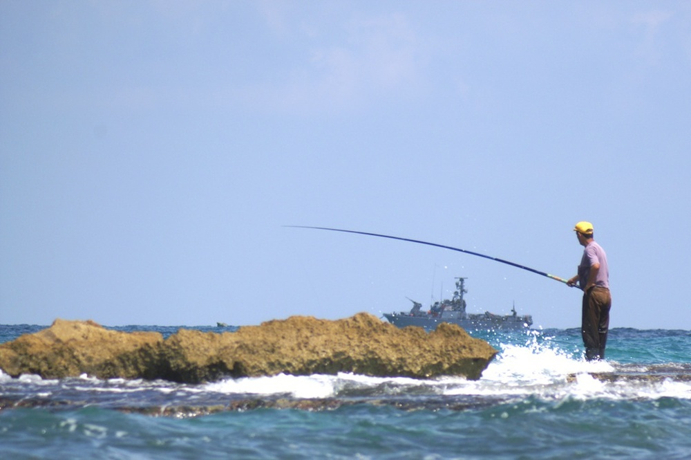 Click photo to download. Caption: An fisherman in Israel. Credit: PikiWiki Israel.