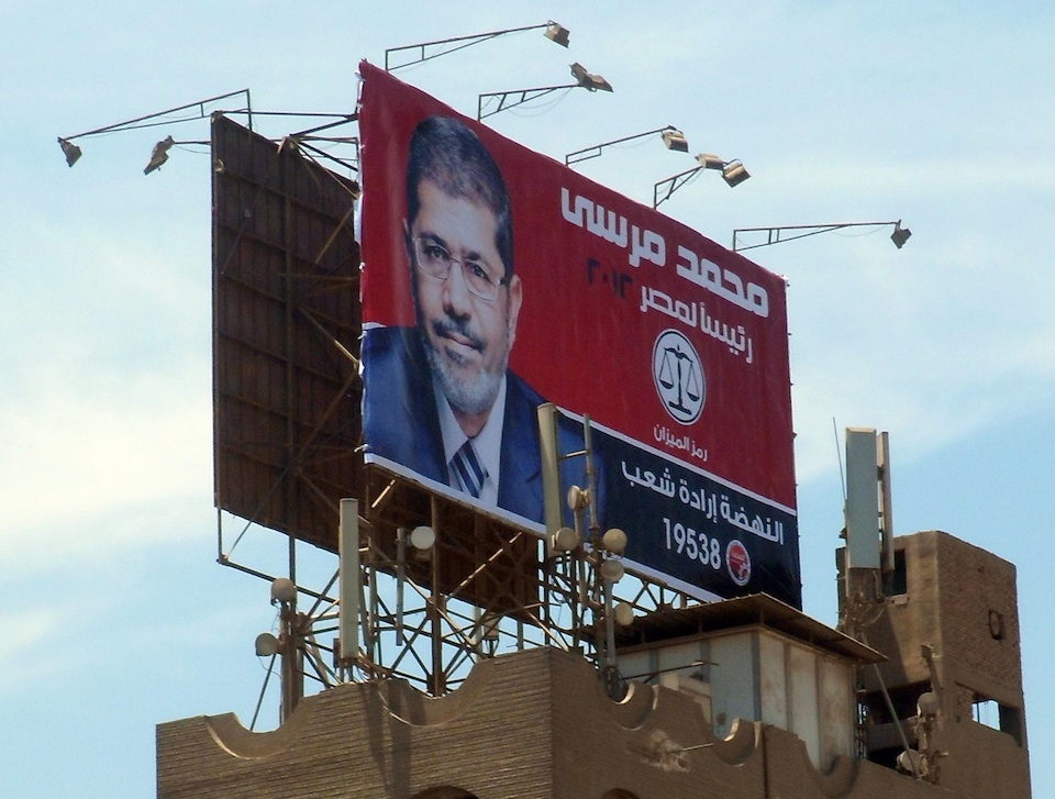 Click photo to download. Caption: In Egypt, a billboard of recently elected Muslim Brotherhood President Mohammed Morsi. Egypt has turned into a major opponent of Israel instead of being a major ally, said media mogul Mort Zuckerman. Credit: Faris Knight.