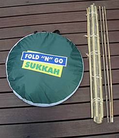 "(Click photo to download. Caption: The Fold ""N"" Go Sukkah in a carrying case, beside a bamboo schach mat. Credit: Leiter's.)"