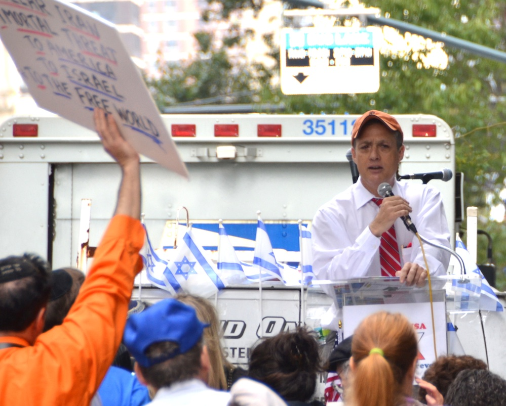 Click photo to download. Caption: Attorney Mark Langfan addressed an enthusiastic pro-Israel crowd that filled the street opposite the Israeli Consulate in New York on Sept. 27. Credit: Maxine Dovere.