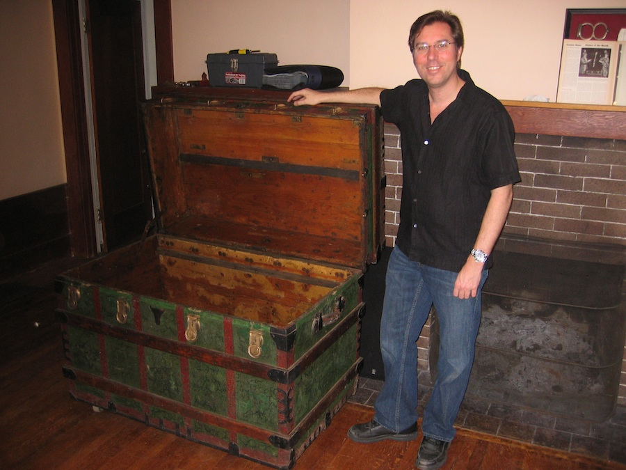 Click photo to download. Caption: Harry Houdini expert John Cox with Houdini's original substitution trunk. Credit: John Cox.
