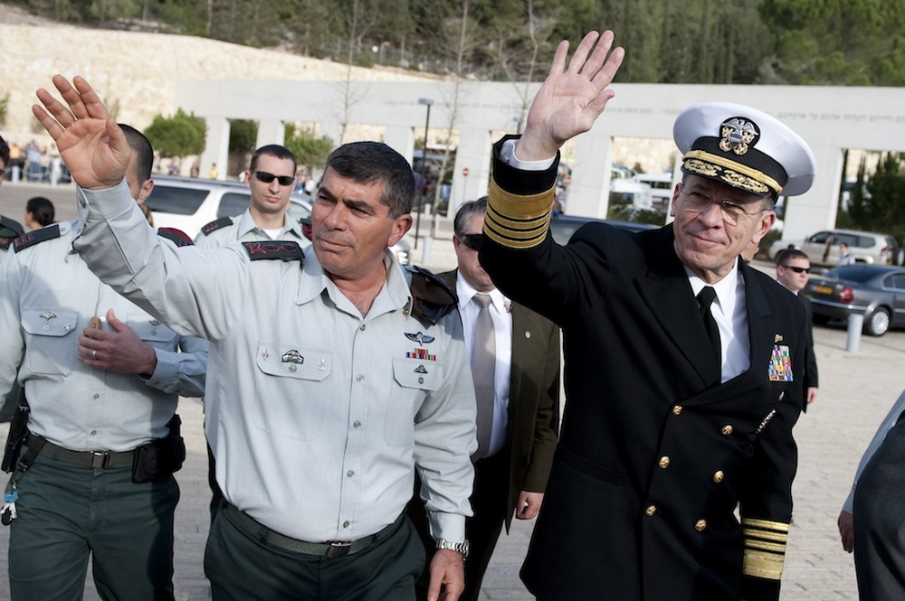 Click photo to download. Caption: Israeli Defense Forces Lt. Gen. Gabi Ashkenazi and Chairman of the Joint Chiefs of Staff Adm. Mike Mullen, U.S. Navy, wave to onlookers at the Yad Vashem Holocaust Memorial Museum in Jerusalem on Feb. 15, 2010. Credit: U.S. Navy.
