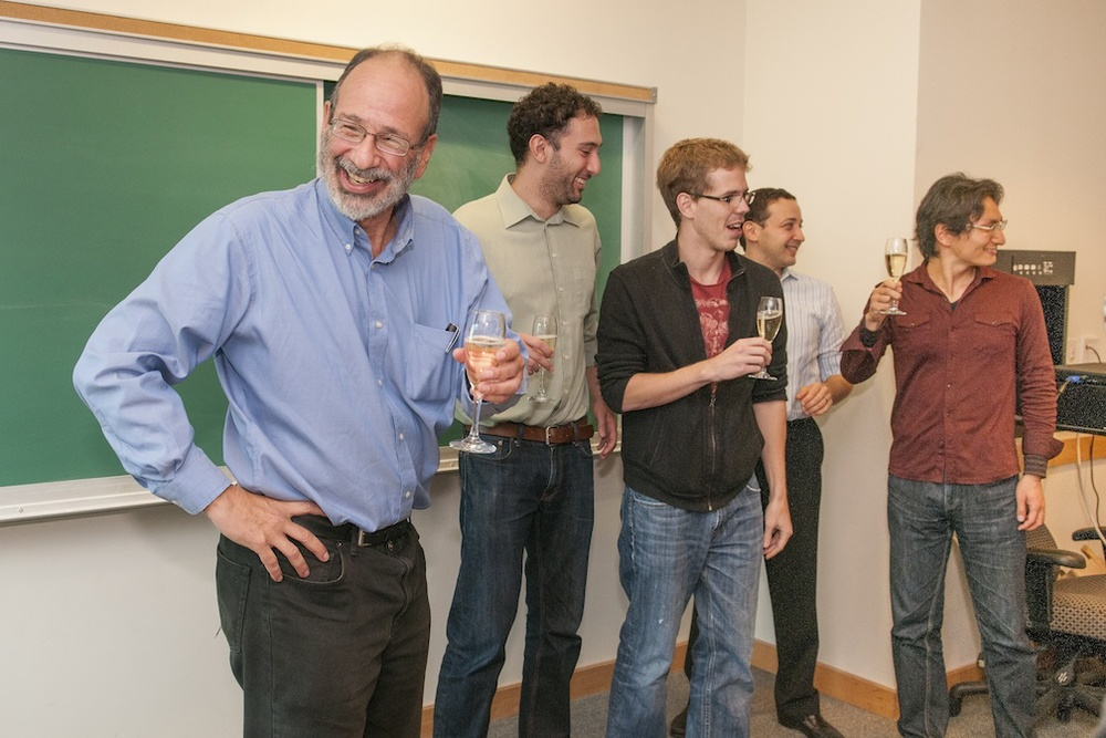 Click photo to download. Caption: Before his morning class, Nobel laureate Alvin Roth, left, receives a champagne toast from his current and former students from Stanford University, second from left, graduate students Daniel Fragiadakis and Peter Troyan, Associate Professor Mike Ostrovsky and Assistant Professor Fuhito Kojima. Credit: Linda A. Cicero/Stanford News Service.