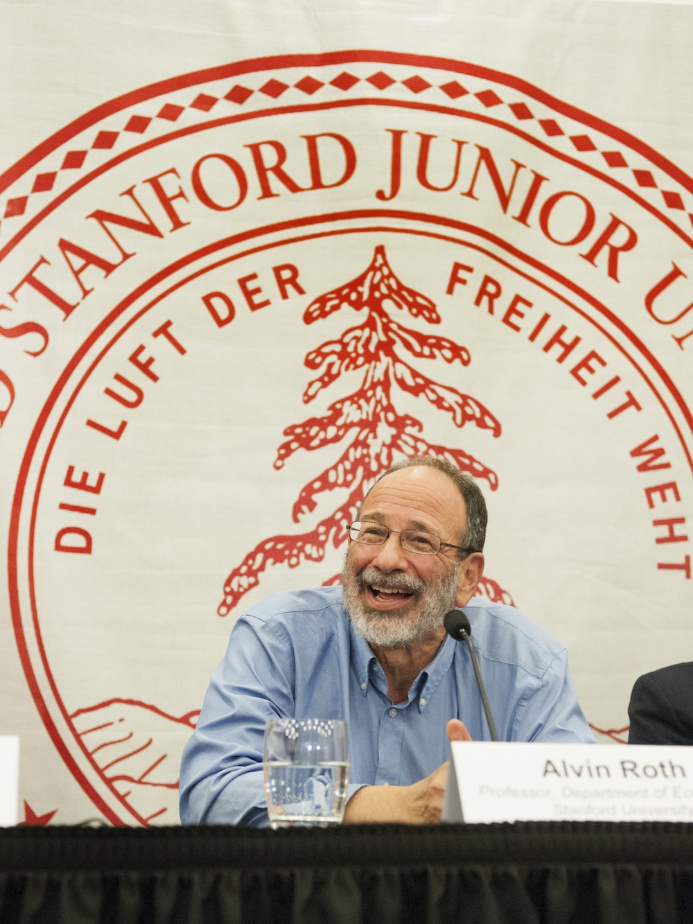 Click photo to download. Caption: Nobel laureate Alvin Roth meets with reporters to discuss the work that led to the Nobel Prize in Economic Sciences. Credit: Linda A. Cicero/Stanford News Service.