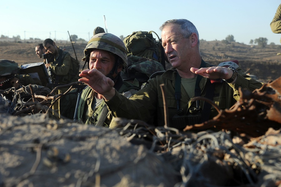 "Click photo to download. Caption: Israel Defense Forces Chief of Staff Lt. Gen. Benny Gantz (R) in action during a live fire exercise for Israeli army battalion commanders taking place in the Golan Heights, Sept. 4, 2012. Syrian tanks entered the Golan Heights demilitarized zone, raising concerns that the ongoing civil war could spill over into Israel. After Syrian tanks entered the Golan's demilitarized zone Nov. 3, Gantz told IDF soldiers the Syrian civil war ""could turn into our affair"" in Israel. Credit: SHAY WAGNER/IDF/FLASH90."